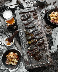 Cherrywood-smoked & Chipotle-encrusted Beef Ribs. Caramelized in a sweet & tangy Carolina Gold BBQ Sauce. Sided by homemade Gruyere-Swiss & Parmesan baked Macaroni&Cheese topped with crushed & dry-roasted pecans. All washed down with a gorgeous ice cold Fresh Coast craft brew. Cheers!  Blog: http://ift.tt/1vCV6pv  #manvswild #ribslikeaboss #outdoorchef #bachelorlife #longlivetheadventure #saveplantseatmeat #grill #bbq #pork #ribs #theotherwhitemeat #whitemeatmatters #bacon #beer #smoke…