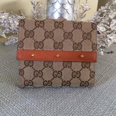 ✨AUTHENTIC GUCCI FRENCH FLAP WALLET✨ Gently used GUCCI wallet.  Brown canvas/British tan leather.  Leather interior with 10 card slots, 2 bill compartments, outside snap coin compartment. Gucci Bags Wallets