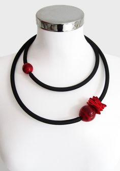 Necklace made with 80% recycled cellulose material, two blown Murano glass beads with pvc tube wrapped netting.Nickel free metallic clasp.Length: 68 cm.Beads diameter: 3.5cm and 2.5cm.