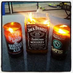 Candles made in empty alcohol bottles