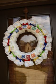 Diaper Wreath.  Use receiving blankets instead!