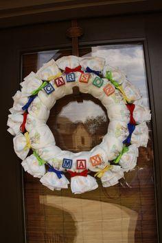 Diaper Wreath.  Use receiving blankets instead!