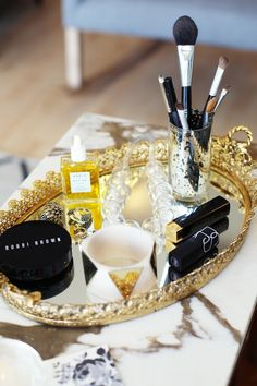 gold vanity tray and accessories ... but I would want silver!!! to match my dream bedroom colours... blue/white/silver and like burlapish