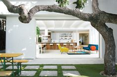 A mature avocado tree shades the hardscaped patio located just outside the great room. Tagged: Outdoor, Grass, and Pavers Patio, Porch, Deck.  Photo 13 of 13 in The Modern Renovated Home of Glee Star Jayma Mays