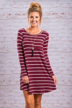 Lucky you! You have found this fab little dress! It's perfect fall color and casual fit are sure to be a great addition to your already fashionable wardrobe! This striped dress is the perfect OOTD!  Material has generous amount of stretch. Chelsea is wearing the small.