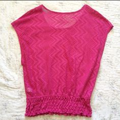 LISTING: PacSun Hot Pink Blouse Purchased at PacSun. -- this blouse is Kirra brand. It is size Medium. It has a banded bottom, which helps the top have its loose, blousy appearance. It was worn once! Excellent condition. It is made with small open holes, a cami (black, pink, white) is needed underneath. This top can be dressed up for work or worn casual. Perfect hot pink color! PacSun Tops Blouses