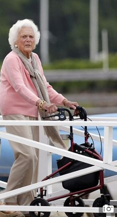 Former first lady Barbara Bush uses a walker as she leaves a luncheon at the Kennebunk River Club on her 90th birthday on Monday in Maine.