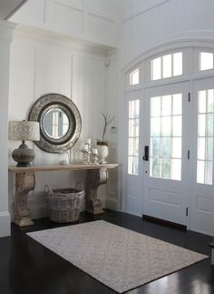 We are loving everything about this entry way! The rug, mirror and table are the perfect invitation into this cozy home.