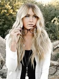 .easy breezy beach look can be achieved with a flat iron and twisting the hair away from the face.
