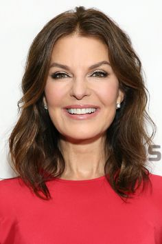 Sela Ward's Middle-Parted Wavy Lob