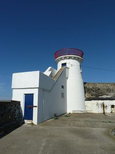 """Balbriggan lighthouse. The lighthouse has a plaques reading """"This pier was built by the Honourable George Hamilton of Hampton in the county of Dublin Third Baron of His Majesty's count of the Exchequer in Ireland whose great object in life was to promote the trade and prosperity in His country ann.dom.1761″"""