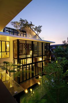 Perfectly lovely modern exterior with rooftop trees - My kind of house!