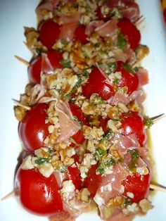 Tomatoes with Serrano ham and walnuts  a slice of serrano ham in a square fold. Ripe cherry tomatoes in half, place the ham in the middle and put together the halves again. Secure with a toothpick.    A vinaigrette with olive oil, white wine vinegar, garlic, salt, pepper and chopped walnuts. Pour the tomatoes with it and can pull up to serve. (German Translated)