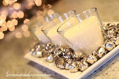 Jingle bells & candles as a centerpiece for Christmas.