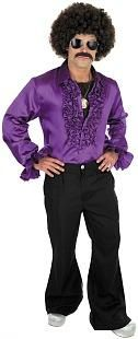 70s Disco Man - purple ruffled shirt, flared trousers and afro wig, stick-on moustache, medallion and silver platform shoes.