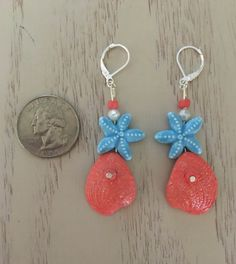 Bright Salmon Colored Earrings with Blue Starfish by PlanetPolly