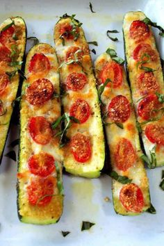 Slice zucchini in half. Brush with olive oil. Top with tomatoes and cheese (mozerella, parmesan). Bake at 375 for 20-30 minutes.