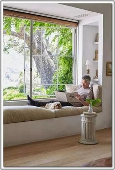 Patina Living & Loving: European Farmhouse Style - Hello Lovely - Patina Living photo of Steve Giannetti with Sophie on built-in window seat bench at Patina Farm. Ph - decorations decor home living room Modern Farmhouse Living Room Decor, Farmhouse Style, Farmhouse Decor, Modern Living, Small Living, Farmhouse Interior, Farmhouse Ideas, Farmhouse Windows, Kitchen Interior
