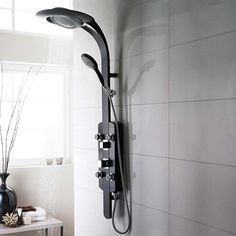 Add a sleek modern style to your bathroom with this black chrome shower tower. #showertower