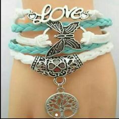 Butterfly wrap bracelet METAL ALLOY  MATERIAL WAX CORD  FAUX LEATHER  LOBSTER CLASP  ADJUSTABLE  ONE SIZE FITS MOST  CHARMS MULTIPLE SEE PHOTOS  OBJECTS MAY LOOK LARGER THAN THEY APPEAR SEE ADDITIONAL PHOTOS FOR ACTUAL SIZE  COLOR WHITE AND TURQUOISE   Comes with a gift box Jewelry Bracelets
