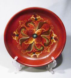 "Gorgeous rosemaling bowl with a rich dark mahogany-colored background (my lighting makes it appear more reddish-orange). It has a 3/4"" green border around the outside edge and a raised gold rim under the green."