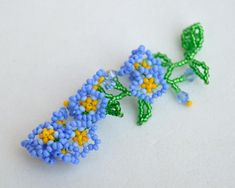 Forget-me-not pendant from Elfin Garden collection Beadwork flower pendant Floral pendant of glass beads Blue and green pendant Blue Beads, Blue Crystals, Beaded Rings, Beaded Jewelry, Blue And Green, Green Pendants, Flower Pendant, Beaded Flowers, Bead Weaving