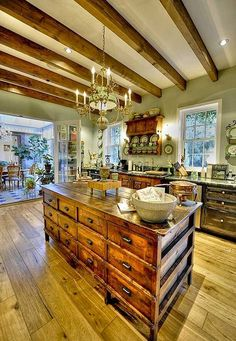 Wood beams and wood cabinets have a ton of orange and yellow in them. The green walls softens the overall mood without using white walls. Green can be really tricky. It can look sick with the yellow of the beams. It is working here but tread lightly