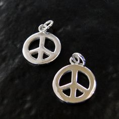 These charms are great for necklaces, bracelets, or earrings. The diameter is 10.3mm, they are relatively thick, at 1mm, with a 4mm ring attached.