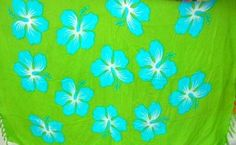 green Hawaiian sarong with blue hibiscus State Flower - http://www.wholesalesarong.com/blog/green-hawaiian-sarong-with-blue-hibiscus-state-flower/