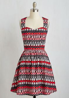 Slip into this lovable cotton dress and doodle the day away! Featuring rows of hearts and swooning skulls in pink, red, and grey, this black dress even has a heart-shaped back cutout to creatively show the world that you're in love with love.