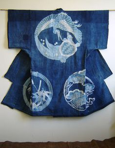 A Nineteenth Century Tsutsugaki Yogi: Sleeping Kimono June 2010 Shown today is a mid-to-late nineteenth century, indigo dyed cotton tsutsugaki yogi, a sleeping kimono onto which auspicious symbols have been hand drawn and resist-dyed. Japanese Textiles, Japanese Fabric, Japanese Kimono, Shibori, Bleu Indigo, Mood Indigo, Yukata Kimono, Kimono Dress, Kimono Duster