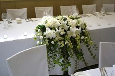 Wedding Flowers for Bridal Table - lillies, hydrangea, ivy, orchids