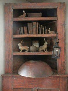 Old Primitive Cupboard.filled with dough bowl, books & primitive rabbits. Primitive Cabinets, Primitive Furniture, Primitive Antiques, Primitive Folk Art, Primitive Country, Primitive Decor, Prim Decor, Country Decor, Country Living