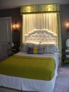 Not a fan of the colors, but the drape idea behind the headboard is legit.