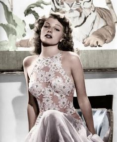 "Rita Hayworth in an amazing white lace and nude illusion gown. Worn in ""You Were Never Lovelier"". Designed by studio designer, Irene. WOW!1!!"