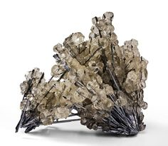 Stibnite covered in Calcite - China