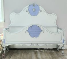 Finished this custom order from my unfinished inventory. Pictures definitely don't do this one justice! The shape of this headboard and footboard are amazing! They requested white silver and a pop of Periwinkle. I added this amazing woodubend to the top and did a French letter raised stencil on the bottom. Hours of detail work!