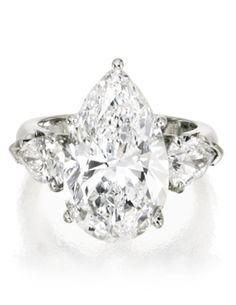 Platinum & Diamond Ring Centered by a pear-shaped brilliant-cut Diamond weighing carats, flanked by two smaller Pear-shaped Brilliant-cut Diamonds weighing and carat, Jewelry Box, Jewelry Rings, Jewelry Accessories, Fine Jewelry, Jewlery, Flower Jewelry, Jewelry Stores, Diamond Rings, Diamond Engagement Rings