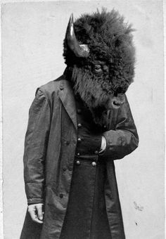 - Buffalo Man, photographer/artist unknown.     Travelers journeying west used to shoot us from trains. Then I found one sleeping, held him at gunpoint, and took his face.     ***  Surely someone knows where this photo of a Buffalo Man came from. I found it here.  See Also: Iris Schieferstein's Pony ; Woman with the horns of a Ram;  Octopus Woman; Porcupine Armor; Soehnee's Silhouette Beasts