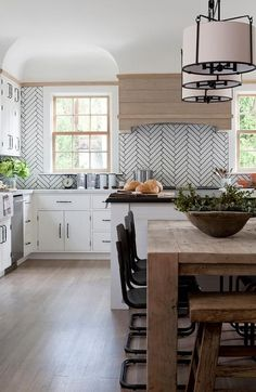 Stunning backsplash and hood - herringbone