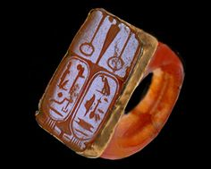 Carnelian ring set in gold with the name of Ramsés II (bottom left)  and his wife Nefertari (bottom right)   1279-1213 BC 19th Dynasty