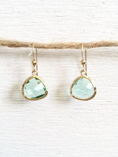 Mint Glass Earrings These are mint colored glass teardrop earrings in a 16 kt gold plated frame. The earrings will look great all year round, but would look really nice with a nice spring or summer outfit. The look like a spearmint color, so pairing them with teal or aqua would make them a great accessory.  Spring/Summer colors to mix and match: teal, aqua, lavender, white