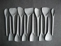 Dark grey, textured porcelain spoons.