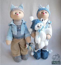 Zwei Katzen mit Teddy