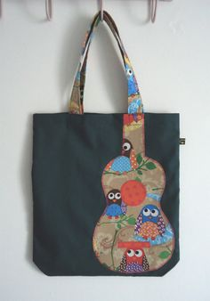 Green tote bag with cute owl print appliqué ukulele