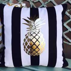 """Black canopy stripes with a gold foil pineapple. This is a perfect pillow to toss in with your pillows at home to give it a little refresh or serve as a fun statement. <a class=""""pintag"""" href=""""/explore/pineapple/"""" title=""""#pineapple explore Pinterest"""">#pineapple</a>,#goldpineapple"""