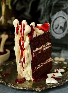 Meringue bone palace Halloween cake - moist chocolate cake filled with vanilla swiss meringue buttercream and raspberry jam covered in meringue bones with berry coulis 'blood' on the side Dessert Halloween, Halloween Snacks, Halloween Cakes, Halloween Sanglant, Chocolat Halloween, Berry Coulis, Marmalade Recipe, New Year's Cake, Swiss Meringue Buttercream