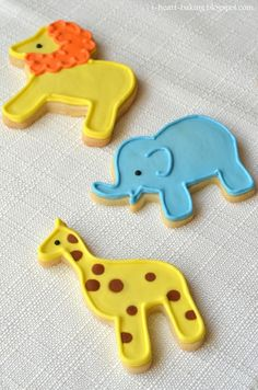 Animal Cookies - Giraffes, Lions, And Elephants animal cookies - giraffe, lion, and elephant sugar cookies with royal icing Lion Cookies, Elephant Cookies, Baby Cookies, Baby Shower Cookies, Iced Cookies, Cute Cookies, Royal Icing Cookies, Cupcake Cookies, Sugar Cookies