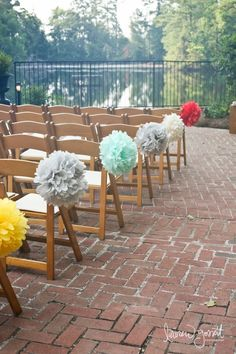 DIY Pompoms - cheaper than floral arrangements on each aisle chair...I would rent these same kind of chairs for the ceremony...they will be the least expensive option. Do in all wedding colors.