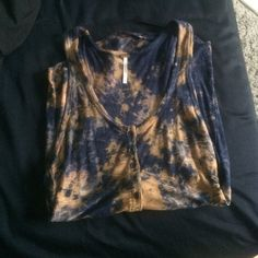 Free people tie dye tank top Free People navy and tan tie dye tank top. size small. great condition Free People Tops